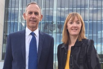 Bob Brown and Jessica Hoyt have their photograph taken outside the High Court in Canberra.