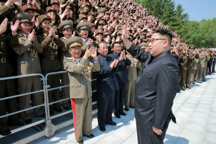 Kim Jong-un greets North Korean scientists