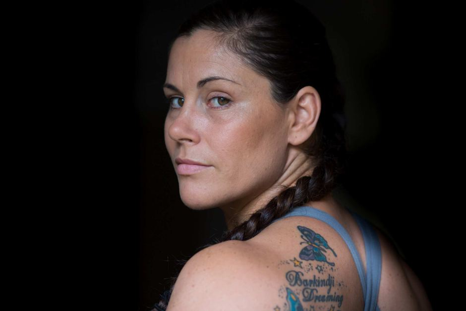 Close-up of jiu jitsu champion Shantelle Thompson looking into the camera, showing a shoulder tattoo.