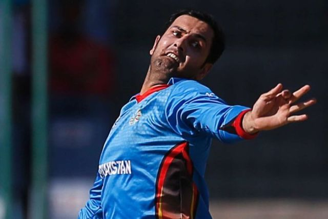 Aghanistan's Mohammad Nabi bowls against England at the World Twenty20