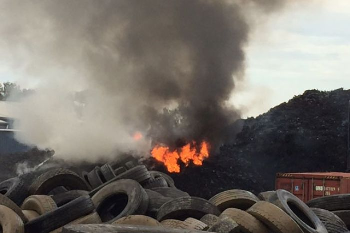 Tyres on fire at Tyremil business at Rocklea on Brisbane's southside