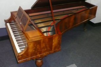 An 1843 Streicher piano — the same model Brahms would have played on.