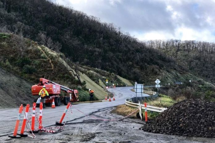 Workman recover parts of the Great Ocean Road between Wye River and Kennett River after landslips.