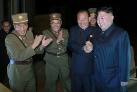 Kim Jong-un celebrates with North Korean ofiicials