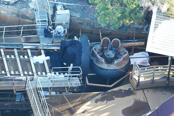 Queensland Emergency Service personnel are seen at Thunder River Rapids ride.