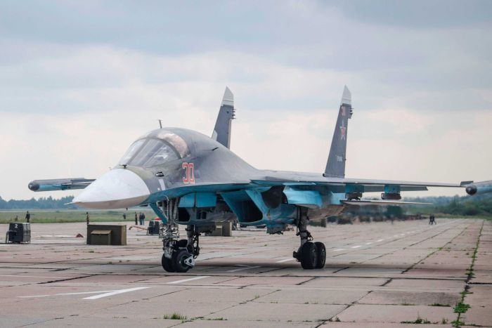 A Russian military jet is parked at an airbase at an undisclosed location in Belarus ahead of joint war games.