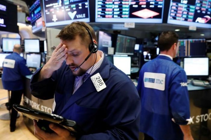 Wall Street trader holds his head