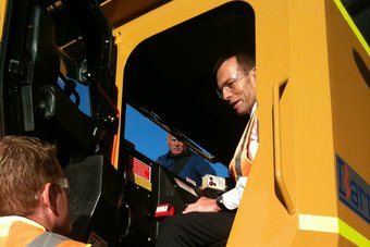 Tony Abbott  in the cab of an excavator