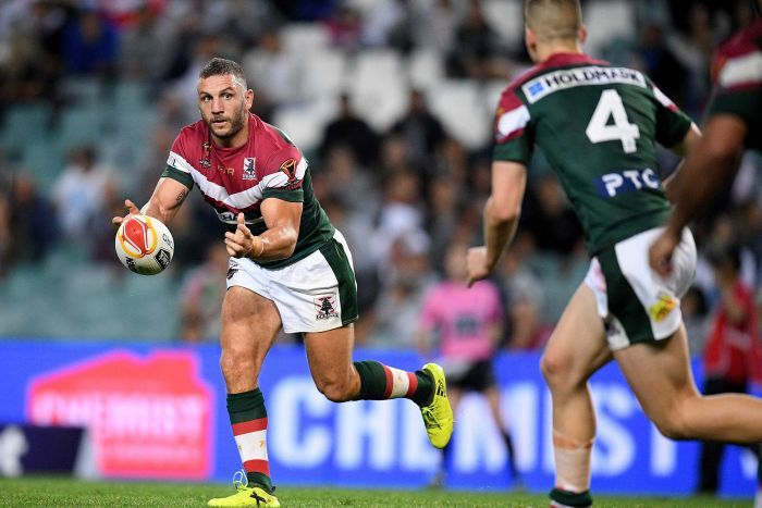 Robbie Farah of Lebanon passes the ball during the Pool A Rugby League World Cup match.