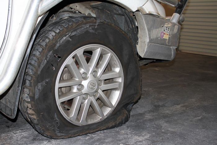A flat tyre of a stolen car