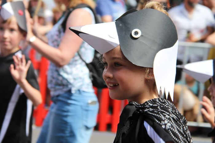 Child dressed in bird costume.