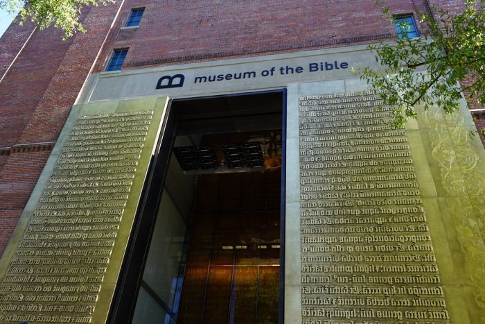 The entrance to the Museum of the Bible in Washington DC, with scripture around the door