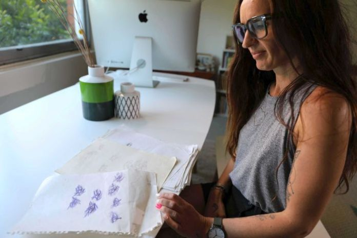 Hayley Blease with some of her drawings she did as a child while being sexually abused.