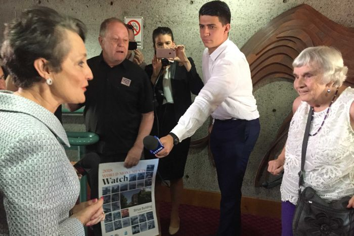Community Services minister Pru Goward meets the last Sirius building resident Myra Demetriou with reporters in background.