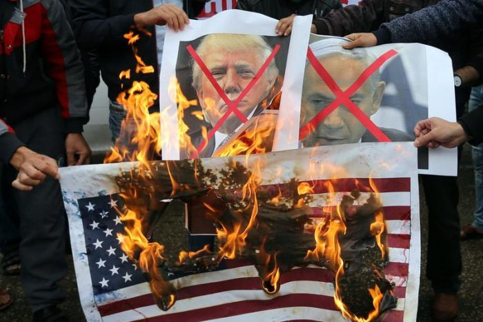 Image result for Images of Burning Trump's photo and U.S flags after Trump announcing Jerusalem issue