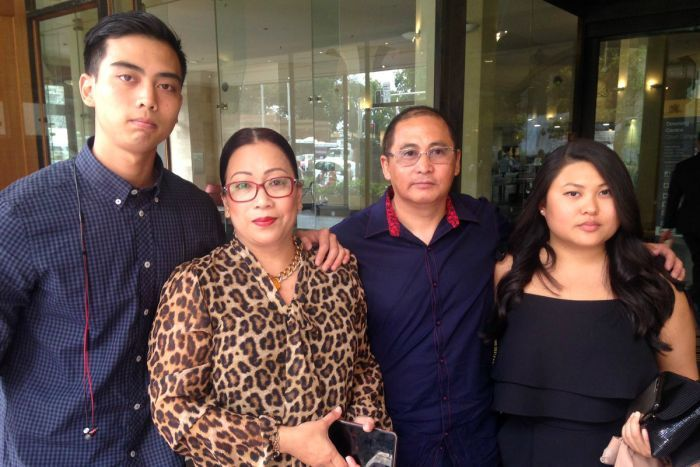 Teresita and Roul Manalad with two of their son's friends, outside a Sydney court