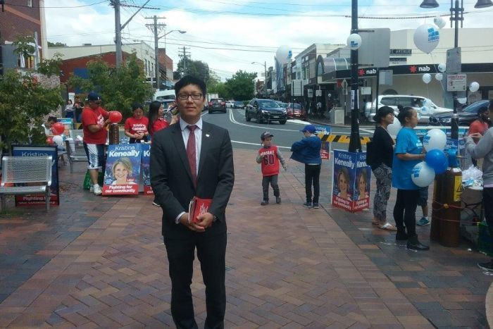 Sean Kim, from the Korean Society of Sydney, stands in Eastwood Mall in the northern Sydney seat of Bennelong.