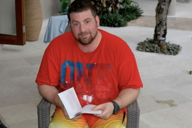 Leigh Aiple reads a book in a holiday snap taken sometime in the year before his death.