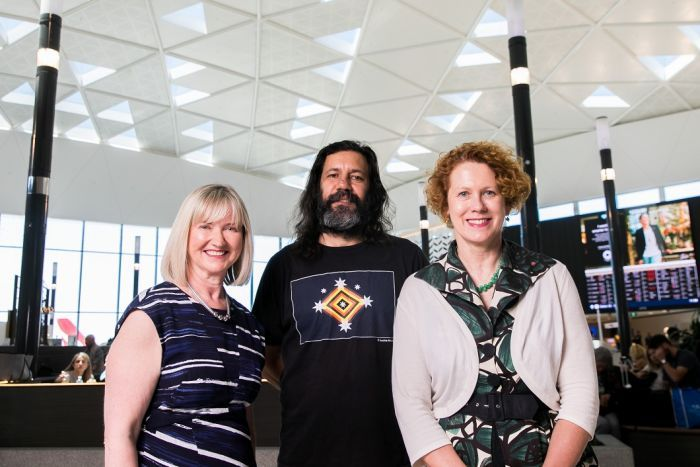 Sydney Airport CEO Kerrie Mathew, Archie Moore and MCA Director Elizabeth Ann Macgregor stand in T1 terminal.