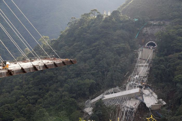 View of a bridge under construction that collapsed over a lush valley in Colombia