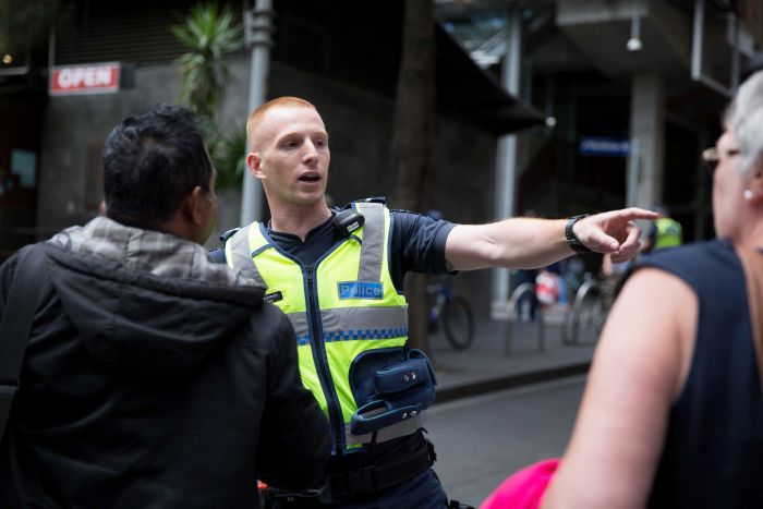 A policeman directs traffic in Melbourne's CBD after the Bourke Street attack