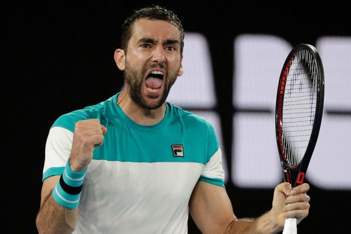 Marin Cilic pumps both his fists and screams out during his Australian Open semi-final against Kyle Edmund.