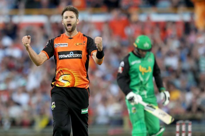 Andrew Tye pumps both fists in celebration of a wicket for the Perth Scorchers.