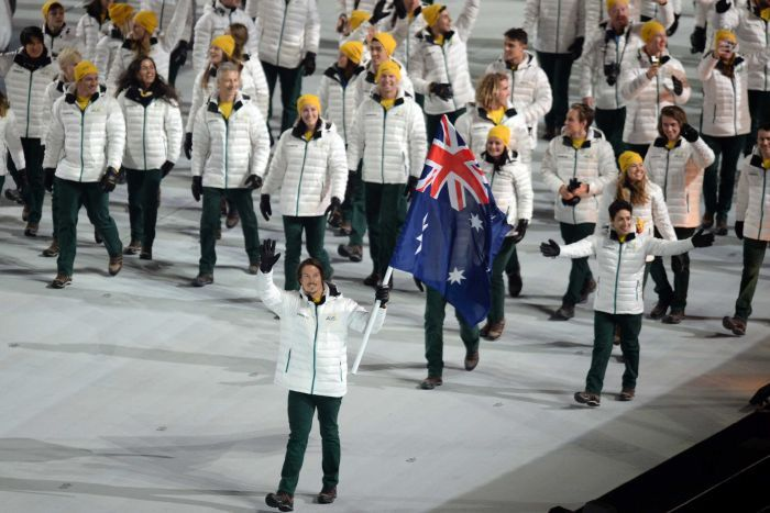 Australia's Alex Pullin (front) carries the flag at Sochi Winter Olympics Opening Ceremony in 2014.