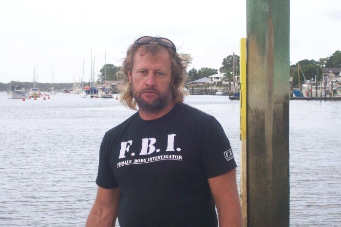 Stephen Armitage poses in a shirt that says 'Female Body Investigator'