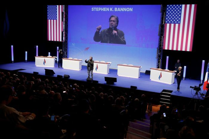 Former White House chief strategist Steve Bannon speaks on stage at a National Front convention.