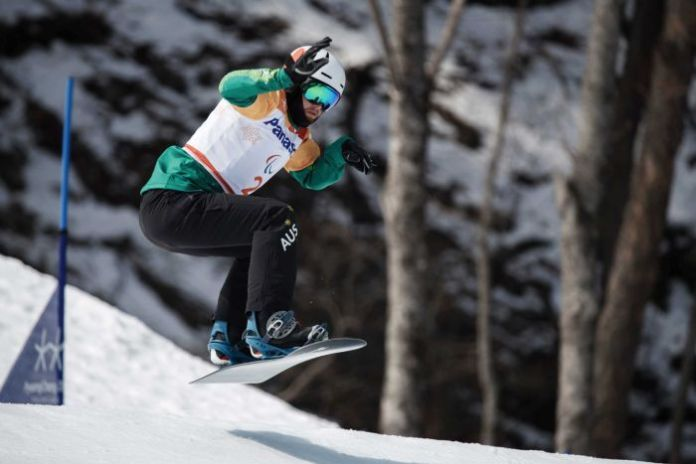 Australia's Simon Patmore competes in men's snowboard cross at the Winter Paralympics