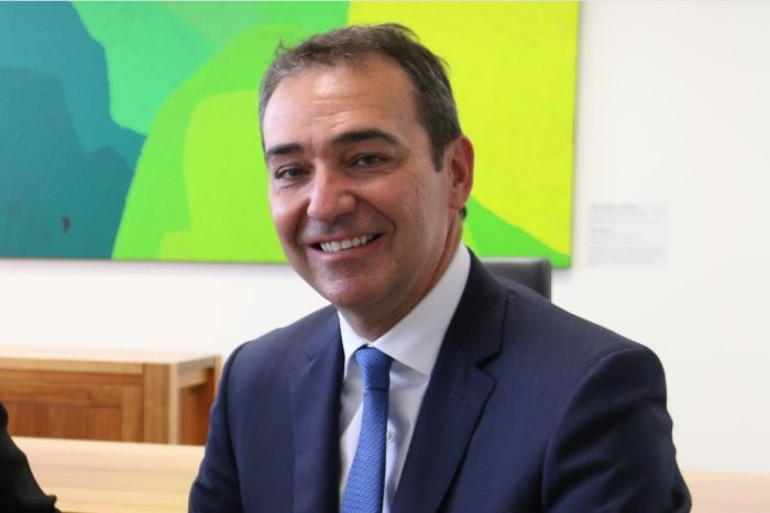 Steven Marshall smiling and seated.