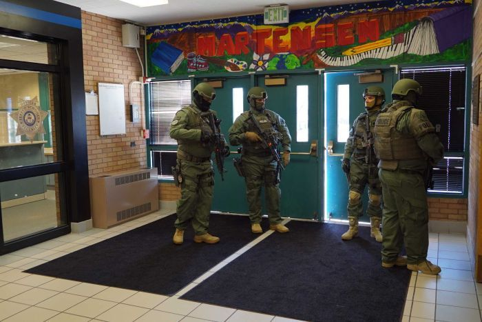 SWAT team is seen inside school.