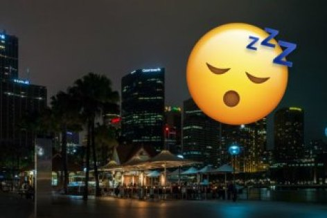 Sydney's skyline at night, with a sleeping emoji above it.