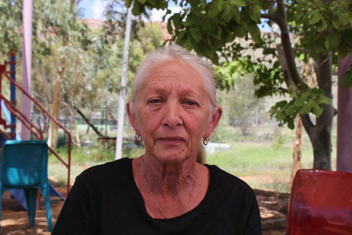 Gamilaroi woman Hazel Collins wearing a Grandmothers Against Removals t-shirt in Alice Springs.