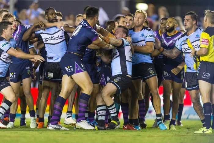 Nelson Asofa-Solomona of the Storm and Paul Gallen of the Sharks square off at the end of the game.