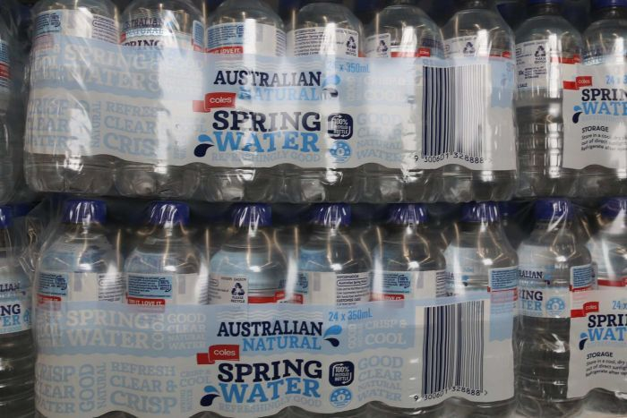Large packs of coles bottled water.