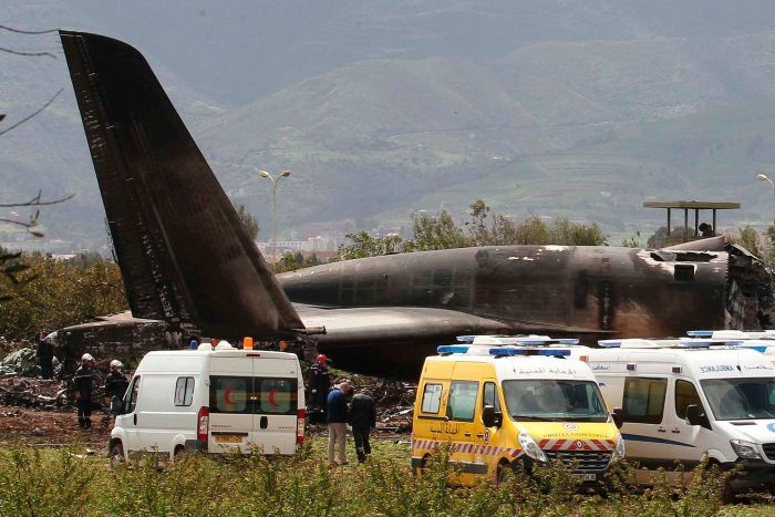 Firefighters and civil security officers work at the scene of a fatal military plane crash in Boufarik, Algeria.