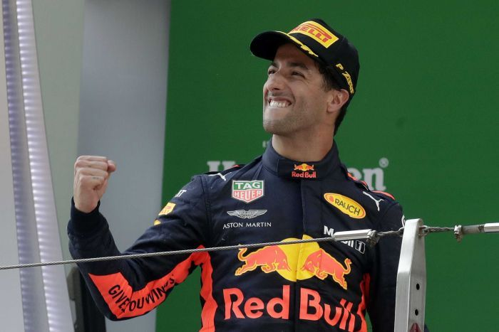 Daniel Ricciardo celebrates winning F1 race