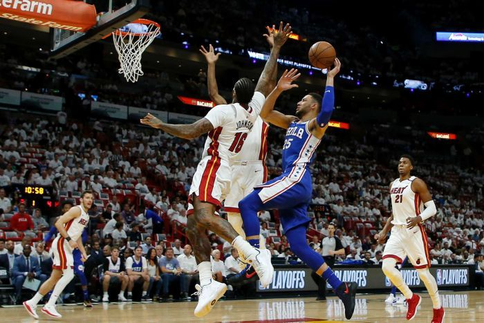 Ben Simmons shoots for the basket against the Heat