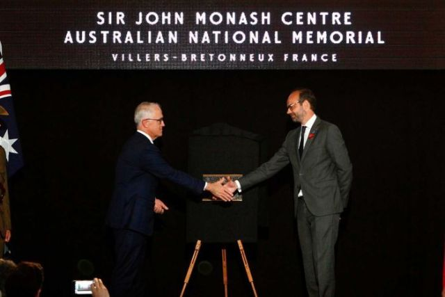 French Prime Minister Edouard Philippe (right) and Malcolm Turnbull unveil a plaque.