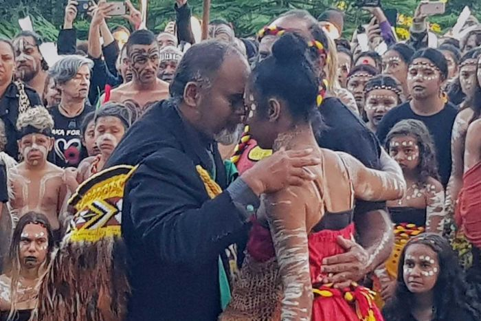 Two dancers embrace after performing the Haka and the Corroboree at Kings Park.