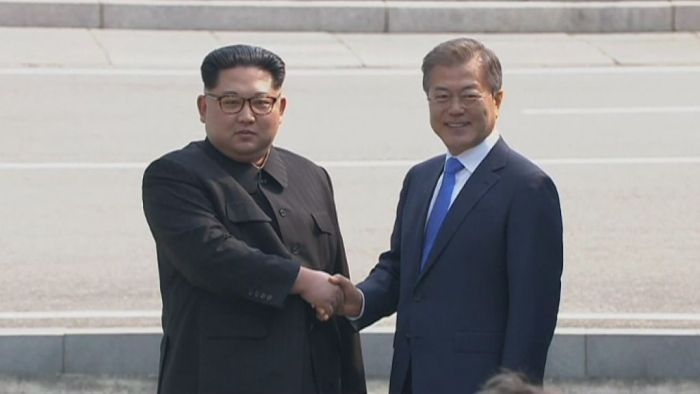 Last month Kim Jong-un became the first North Korean leader to walk across the border between the North and South. (Image: AP)