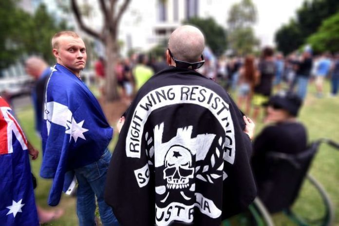 Ethan with southern cross flag draped over shoulder.