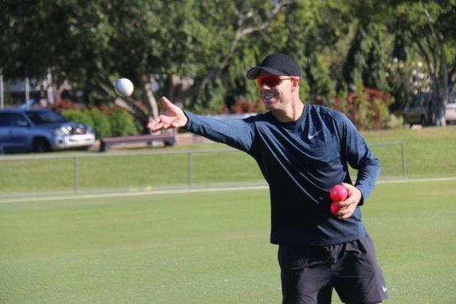 David Warner throws a ball in Darwin at a cricket session for women.