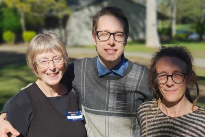 Wilson Hoyle posing for a photo with his mother (r) and grandmother (l)