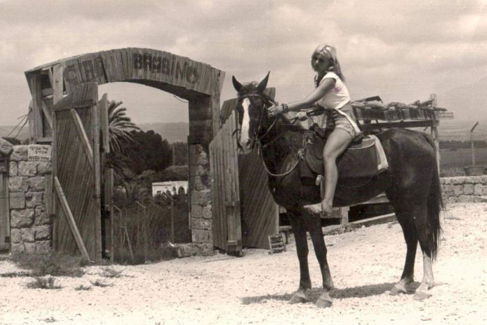 Rina Avivi seen in the 1970s riding her horse near the museum.