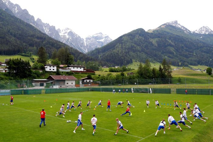 Russia's squad training with mountains in the background.