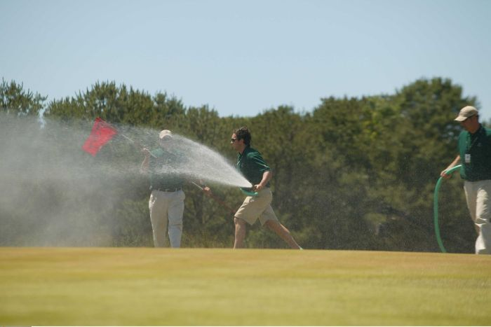 Staff water the grass at Shinnecock Hill during the 2004 US Open golf tournament