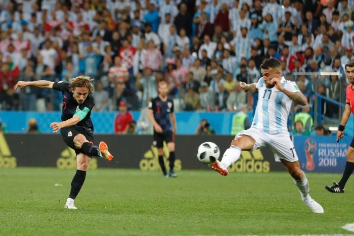 Luka Modric hammers the ball home against Argentina